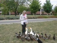 This is my roomate feeding the ducks at the duck pond behind our dorm.